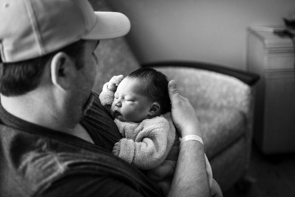Proud dad admiring his baby.