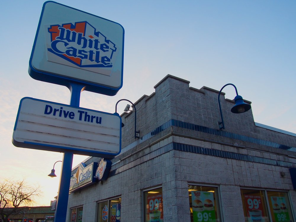 White Castle  - An American staple and pioneer of the burger chain, White Castle and their unique square-patty sliders have been doing it right since 1921. Jonathan Lethem knows a good thing when he eats it and so should you. Simple: meat, cheese, ketchup, pickle, and grilled onions. They no longer cost a nickel, but these sliders are worth the price hike. So, get down to a restaurant and enjoy one or fifteen of these delicious bite-sized treats.