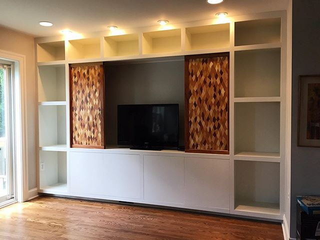 The sliding doors open to reveal space adequate for a TV.