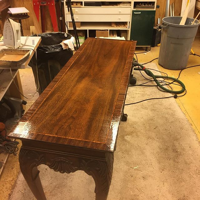 This is a hall table I'm in the process of refinishing for a customer.  The tabletop was damaged.  I removed the old finish, replaced the outer edge with mahogany, and re-stained to match.  I'm now rebuilding the finish in order to polish to a mirror surface.  I'll post another picture when it's complete.