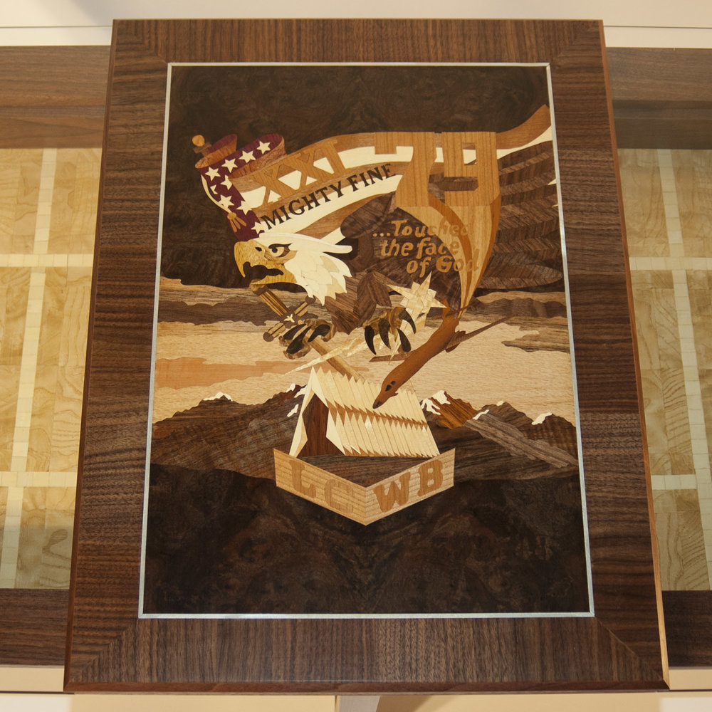 US Air Force Academy '79 Class Crest   The  Shadowbox Coffee Table  has a center panel that can be done in marquetry with the emblem of your choice.  This panel is the 1979 class crest for the US Air Force Academy.