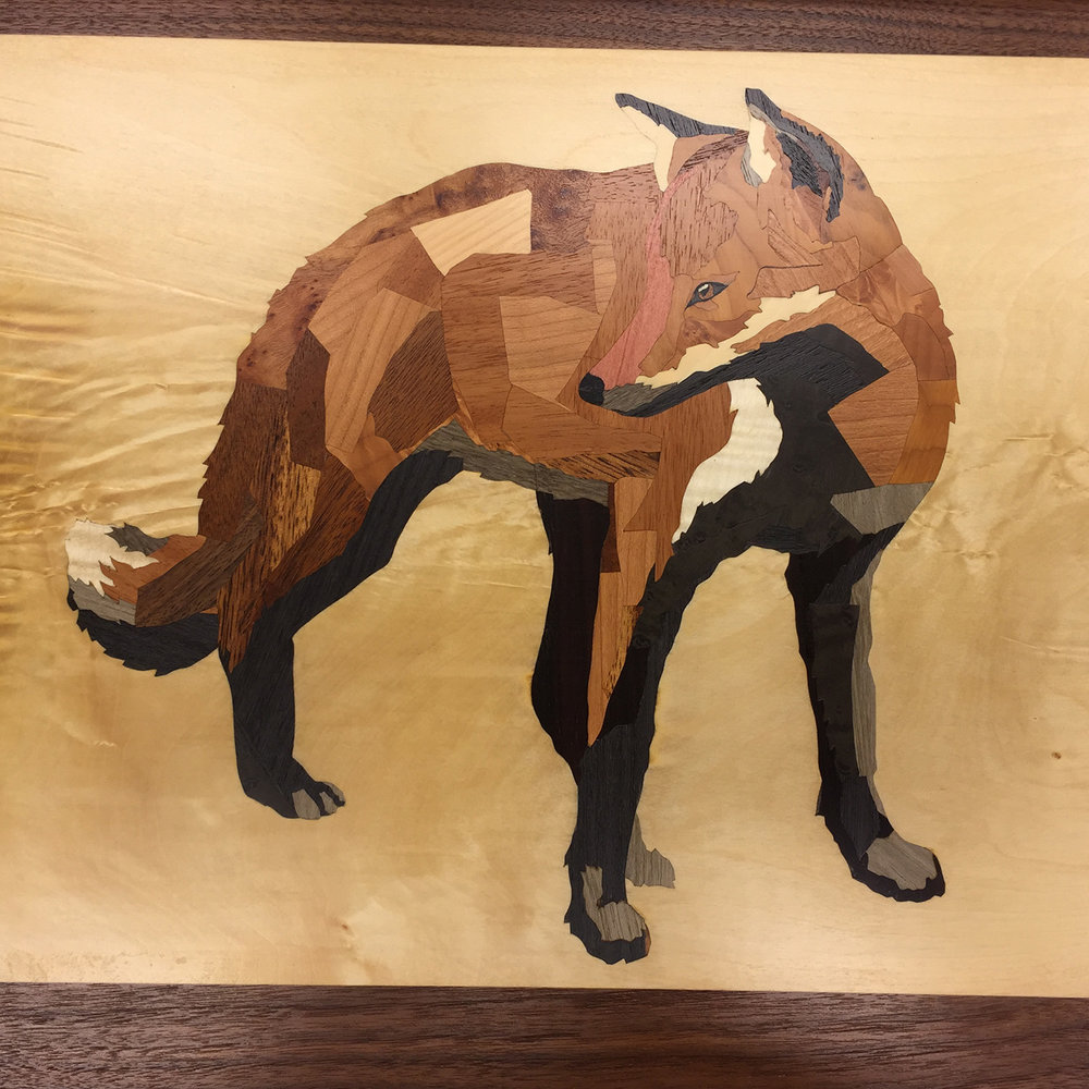 Darren Booth Fox Collage, in marquetry   Darren Booth is a collage artist.  He created an iconic fox image that I thought would look excellent in marquetry.  With his permission, I made a serving tray featuring this marquetry.