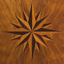 Compass Rose within French Walnut   Inlaid Compass Roses are a specialty.  This one decorates the center of a dining table.  My standard compass rose has 16 points, 32 pieces, and is comprised of 2 contrasting woods.