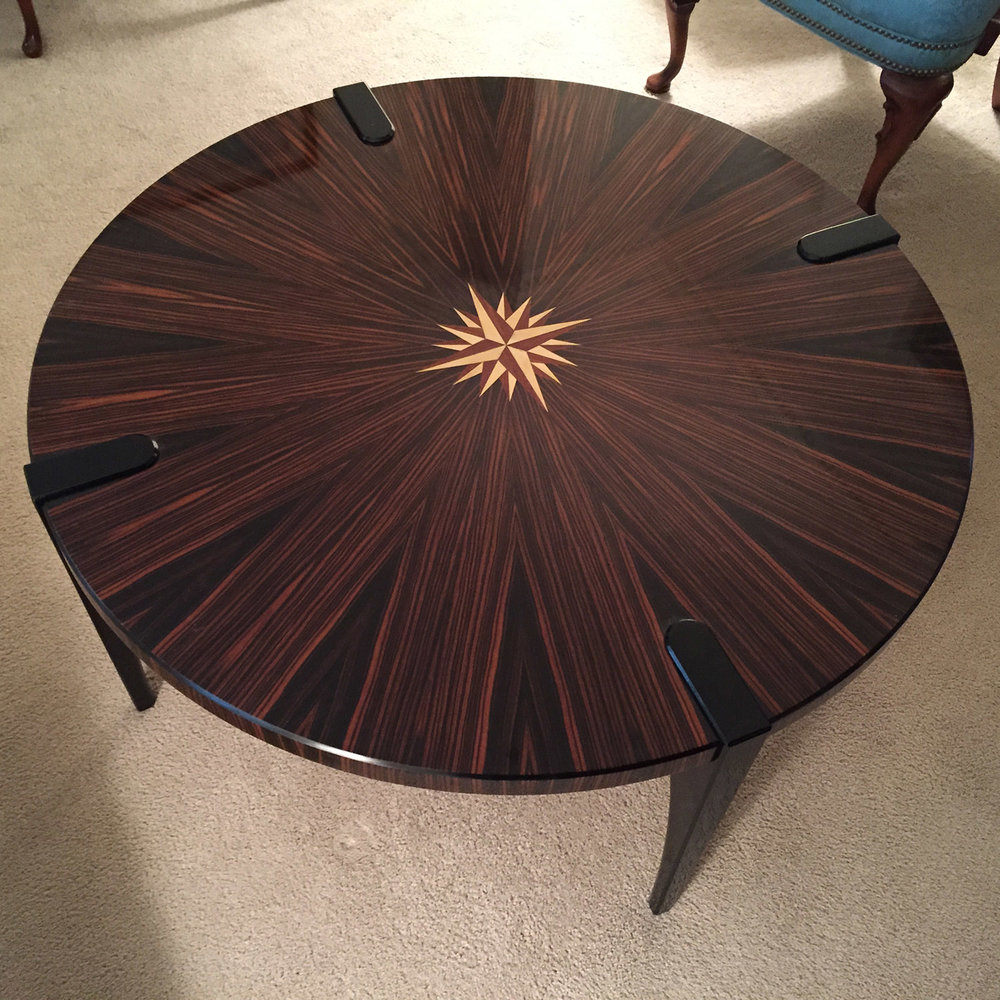 Straight Grain Macassar Ebony      Steve's Coffee Table    is a 16-sector pie-matched tabletop, made of straight grain Macassar ebony.  The seams of these 16 pie slices align with the 16 points of the inlaid compass rose.