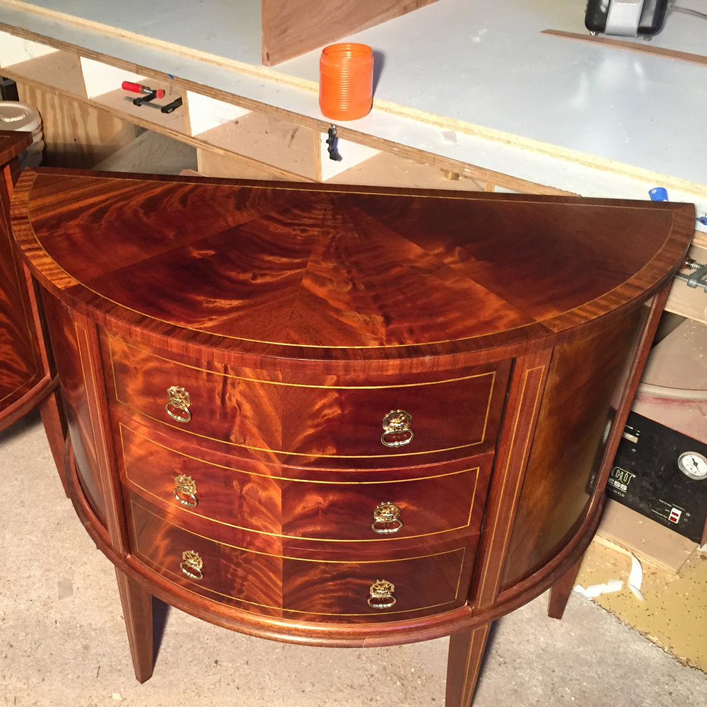 Crotch Mahogany   It doesn't have to be a round surface to use pie-matching.  Here, a 4-sector pie match of crotch mahogany decorates the top of this    demilune chest   .