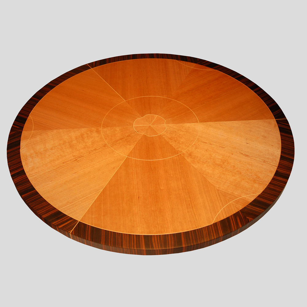 Straight-Grain Cherry   The tabletop of    Greta's Coffee Table    uses a 6-sector pie-match of cherry, surrounded by an outer border of Macassar ebony.
