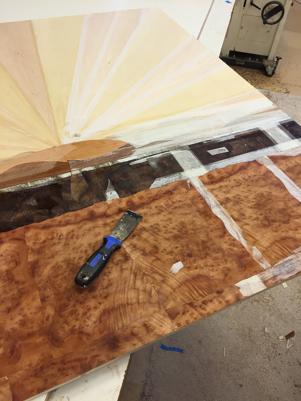 Removing veneer tape from the display's background.