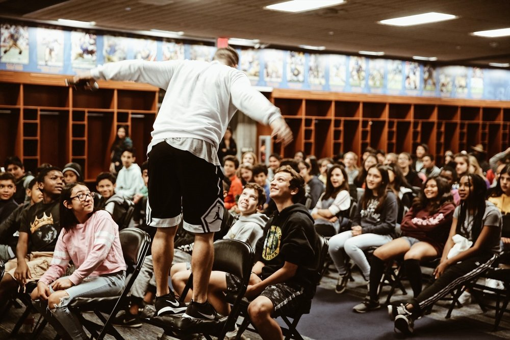 Motivational speaker, Jesse LeBeau, speaks to 7th grade students from PUSD during the Honda Field Trip to the Field program. The program ensures that every seventh grader in PUSD visits the Rose Bowl Stadium for a professional tour, a PE activity on the iconic field, a healthy lunch, and a motivational speech (photo from 2018).
