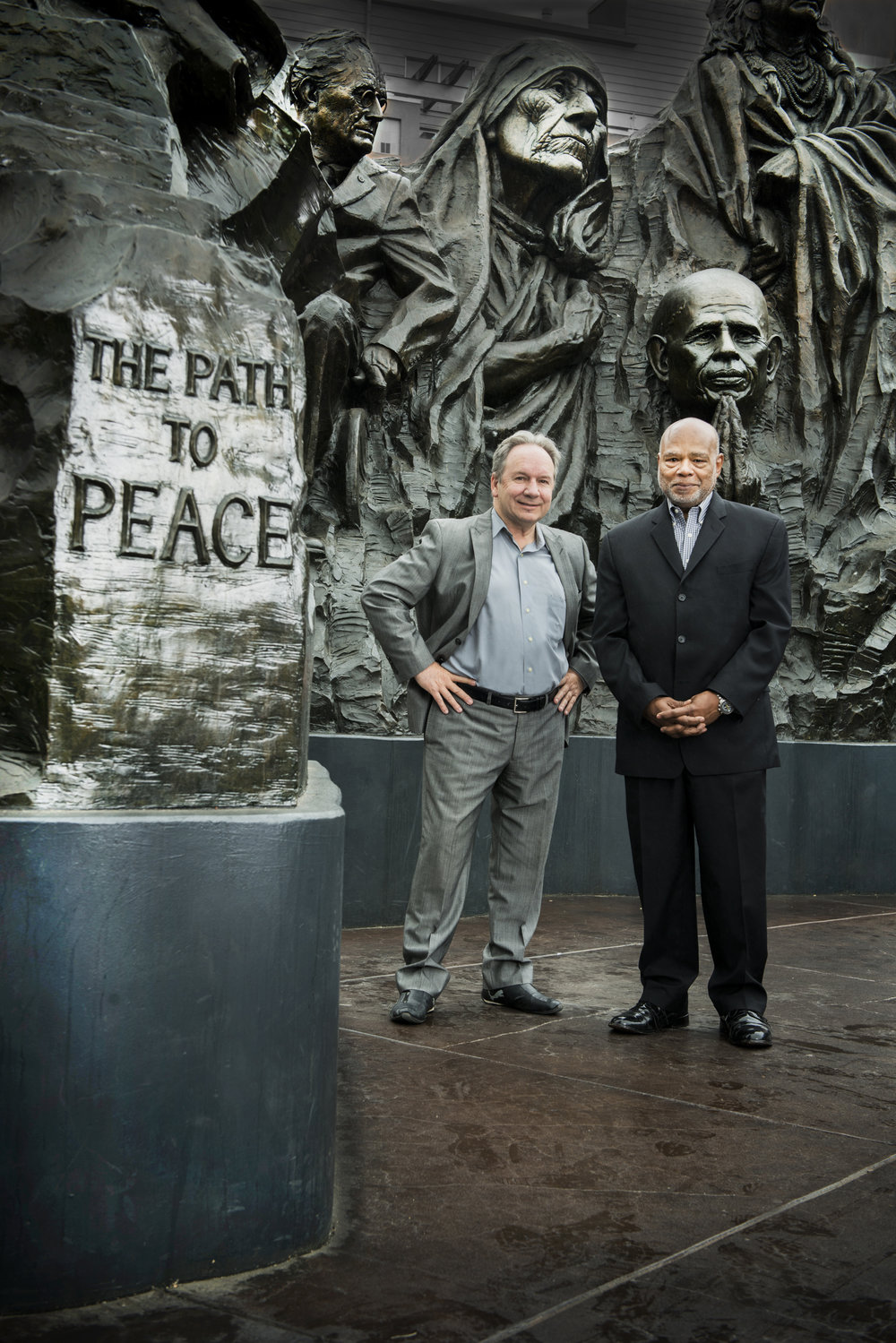 "Concept authors  Philip Banta and Norman Hooks in front of the ""Remember Them: Champions of Humanity"" monument at Oakland's Henry J. Kaiser Memorial Park on 19th St. along the north leg of the West Oakland Walk"