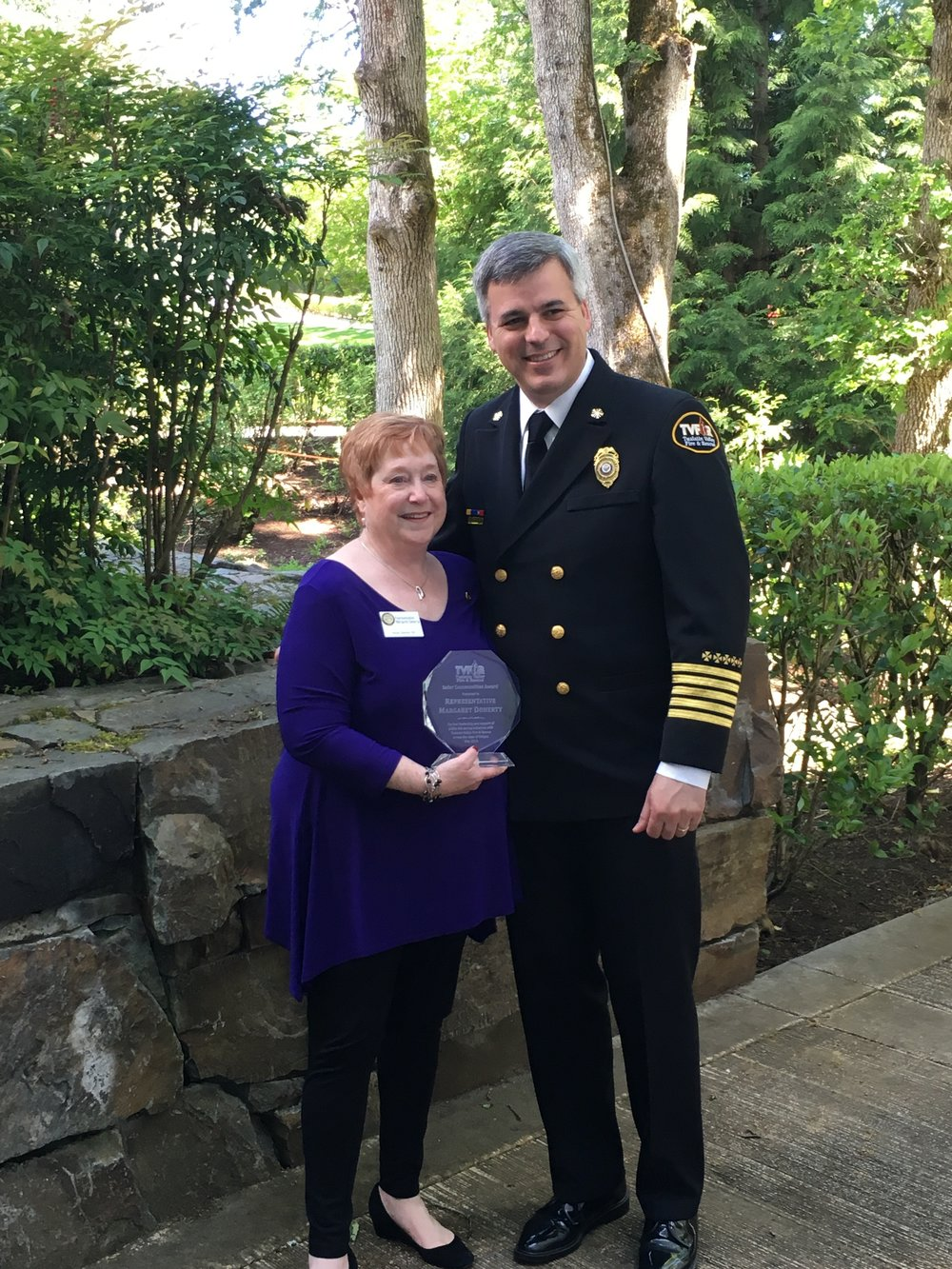 One of my favorite pictures of MD. She's standing next to Tualatin Valley Fire & Rescue Chief Mike Duyck receiving an award for her work in the legislature.