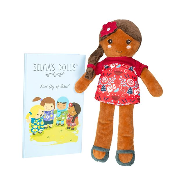 "Every Selma's Doll comes with a book- ""Selma's First Day of School"". Not only is the story perfect for back to school, but it's also the perfect introduction to a conversation with your little one about how beautiful all people are. Get yours today on Amazon!"