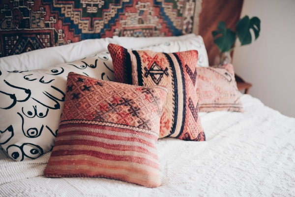 Square kilim pillows in bohemian bedroom from Foraged Home