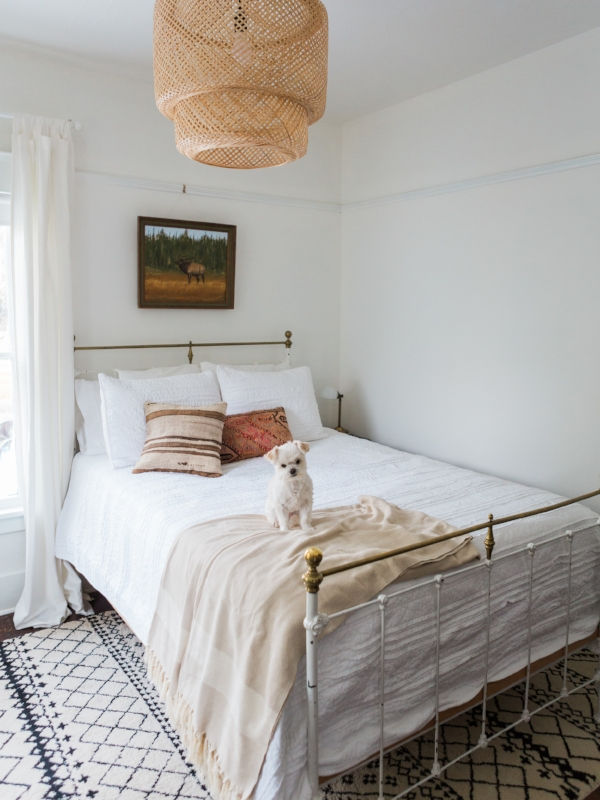 All white bedroom with bohemian and vintage charm