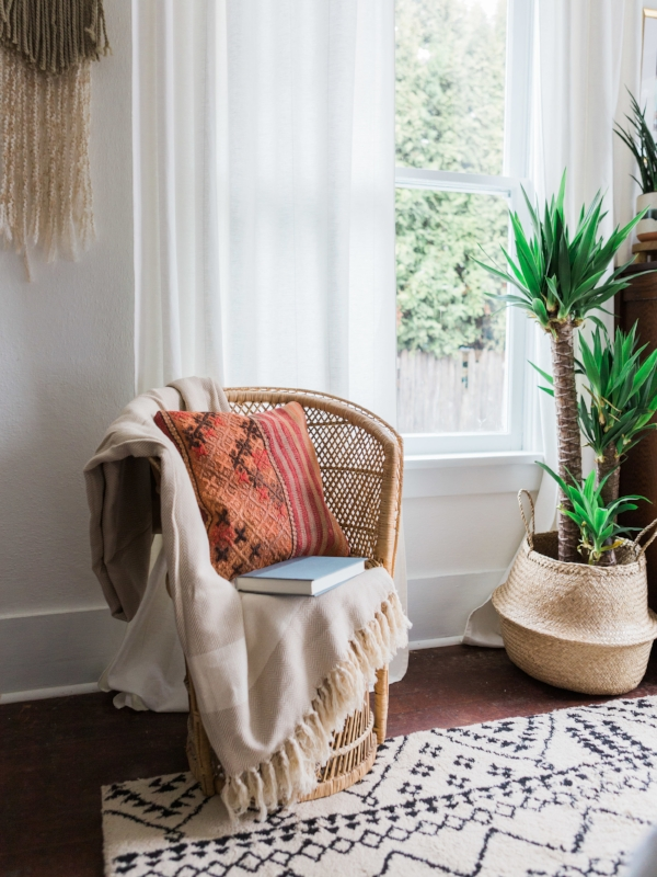 Boho reading nook with red kilim pillow by Foragedhome.com