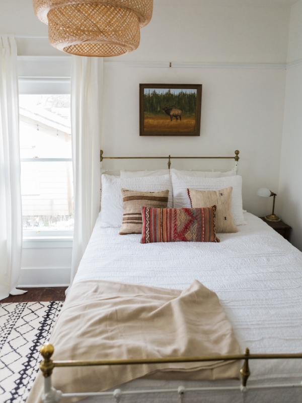 Simple and clean bedroom with bohemian flair and accents by Foragedhome.com