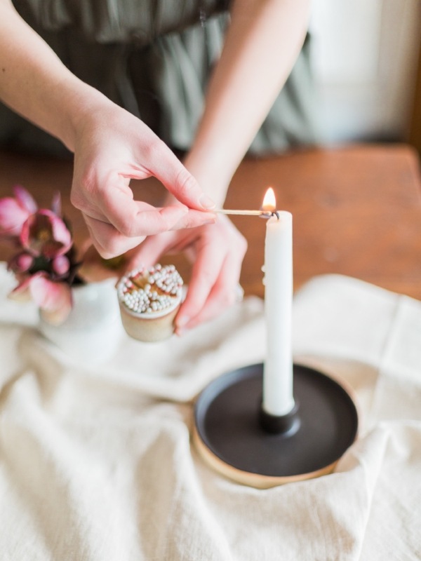 Ceramic match striker and ceramic taper candle holder via Foraged Home