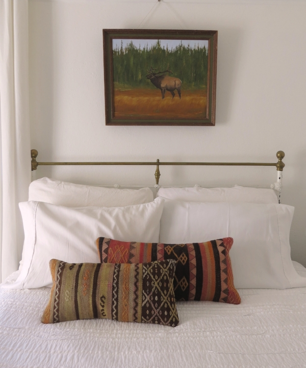 Simple bedroom decor and bed pillows from Foraged Home