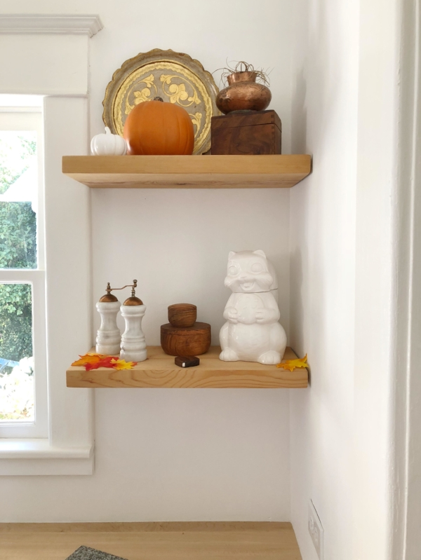 White kitchen with open shelving decorated for fall/autumn with pumpkins from Foragedhome.com
