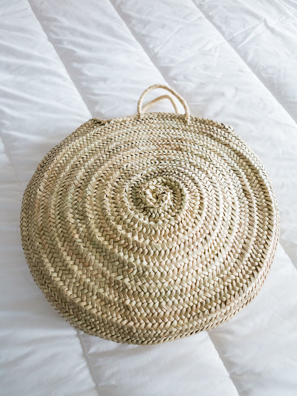Large round straw tote basket from Foraged Home