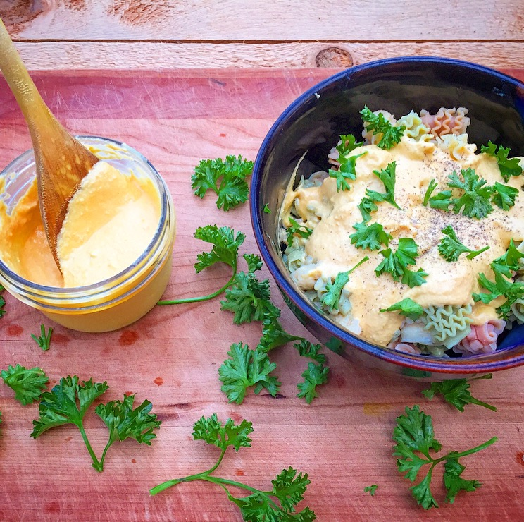Pictured is the cheese sauce over quinoa pasta topped with black pepper and fresh parsley.