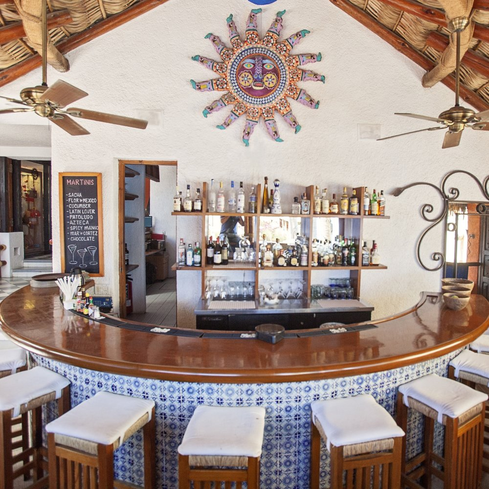 Casa Natalia Mi Cocina:   The bar in this boutique hotel is classy AF. They make an exquisite house Margarita and employ the only bartender in the Americas who doesn't look cheesy in suspenders.