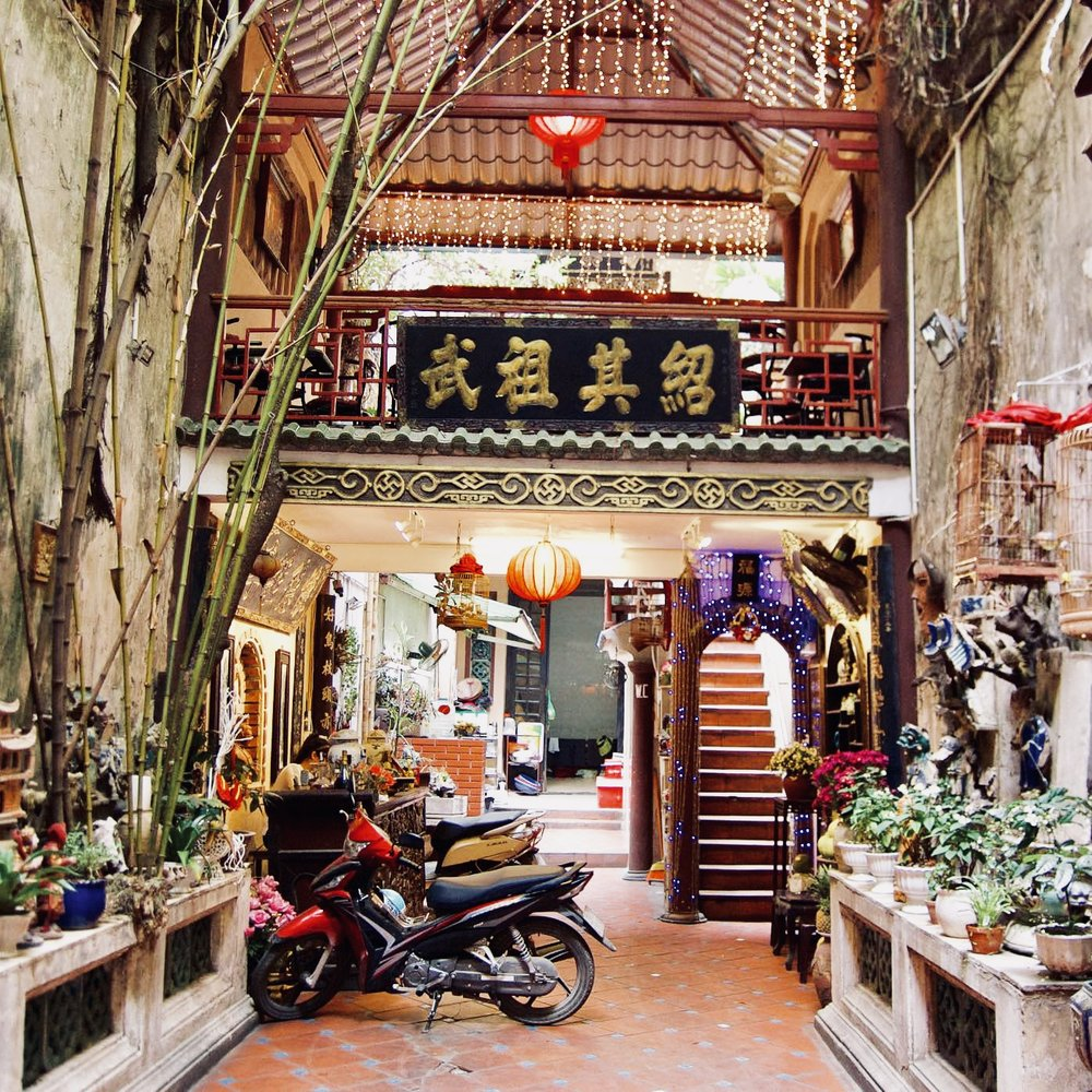 Cafe pho co:  You can walk by the entrance of this cafe without realizing, tucked down a long dark hallway between silk shops, a beautiful garden appears out of nowhere. The egg coffee here is one of the best.