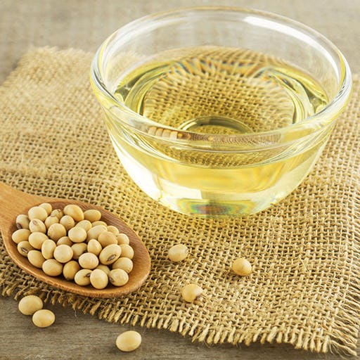 soybean oil and soybeans on a wooden table