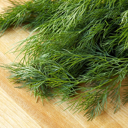 dill herbs and plants on a chopping board