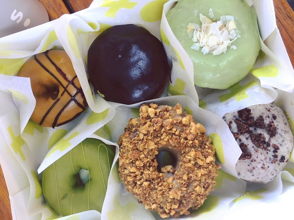 Mocha, Boston creme, Pandan Coconut, Triple Matcha, Maple Walnut Brown Butter, Cookies and Cream