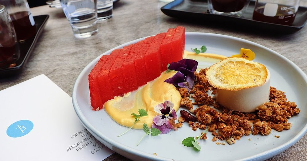 Rosewater Compressed Watermelon with Lemon Myrtle Panna Cotta, yuzu bee pollen curd, and wattleseed granola