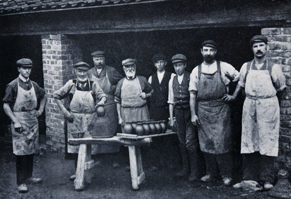 The workers at Fremington in 1907. On the far left is William Fishley Holland. Fourth from the left is his grandfather, Edwin Beer Fishley.