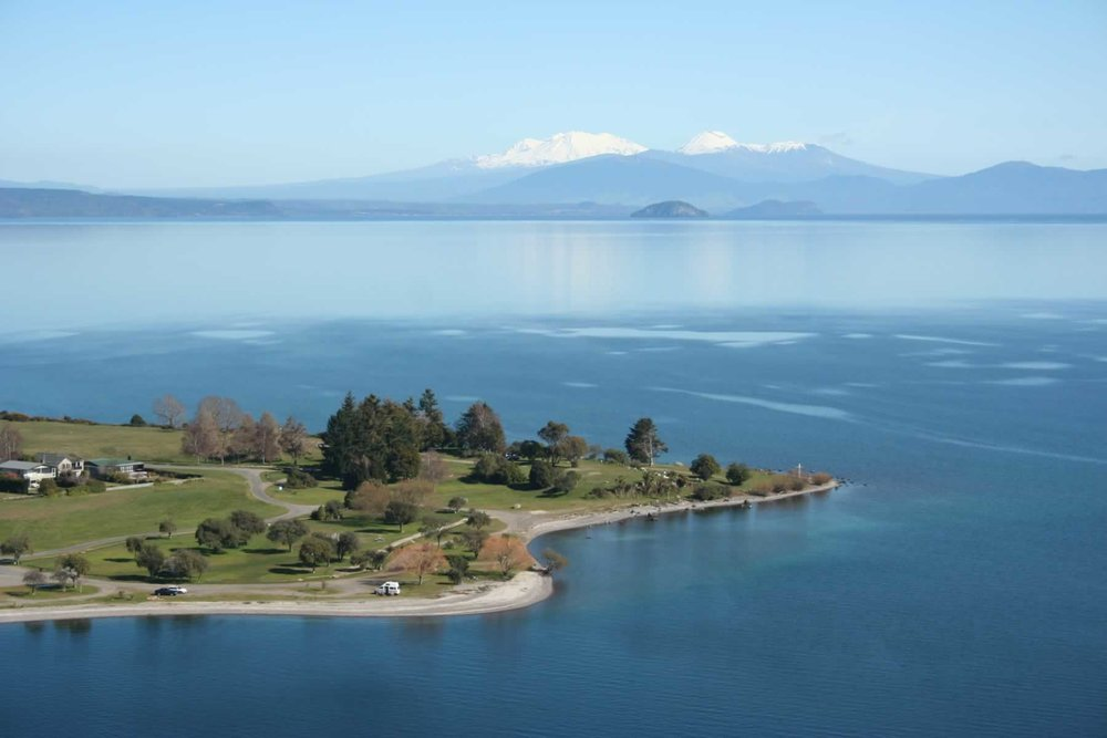 Aerial-view-of-Taupo-town-looking-south-over-Wharewaka-Point-with-mountains-in-winter.CEXVsg.jpg