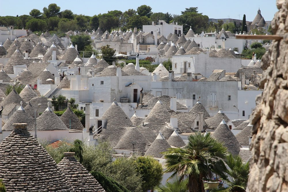 Trulli - Alberobello, ItalyA trullo is a traditional Apulian dry stone hut with a conical roof. Their style of construction is specific to the Itria Valley, in the Murge area of the Italian region of Apulia.