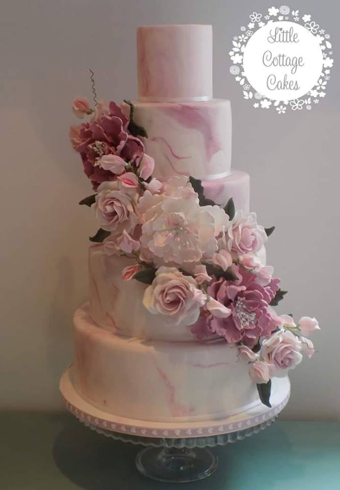 1.Big Cakes Are Back! - Cupcakes and dessert racks dominated the Wedding scene for the past four years. For 2019 the trend has returned to tiered cake with a few on-point flourishes.Sonja Izaguirre of Little Cottage Cakes says