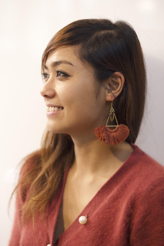 Jennie wearing    Terre Rouge Sega Dance Earring
