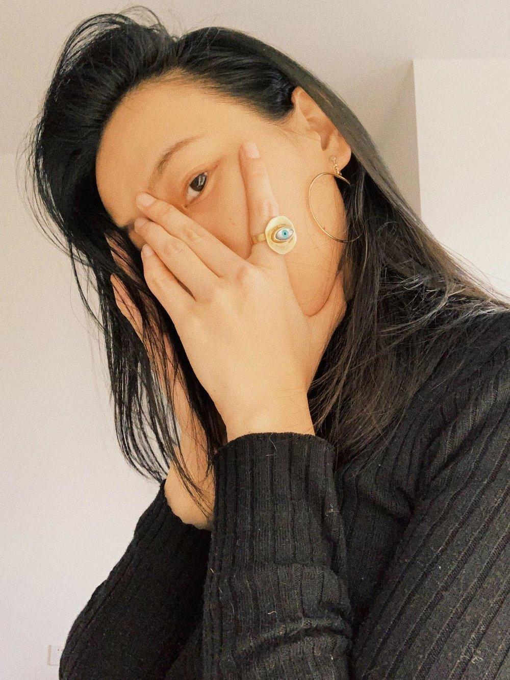 Hong Tiny Monster wearing    Silver Third Eye Ring