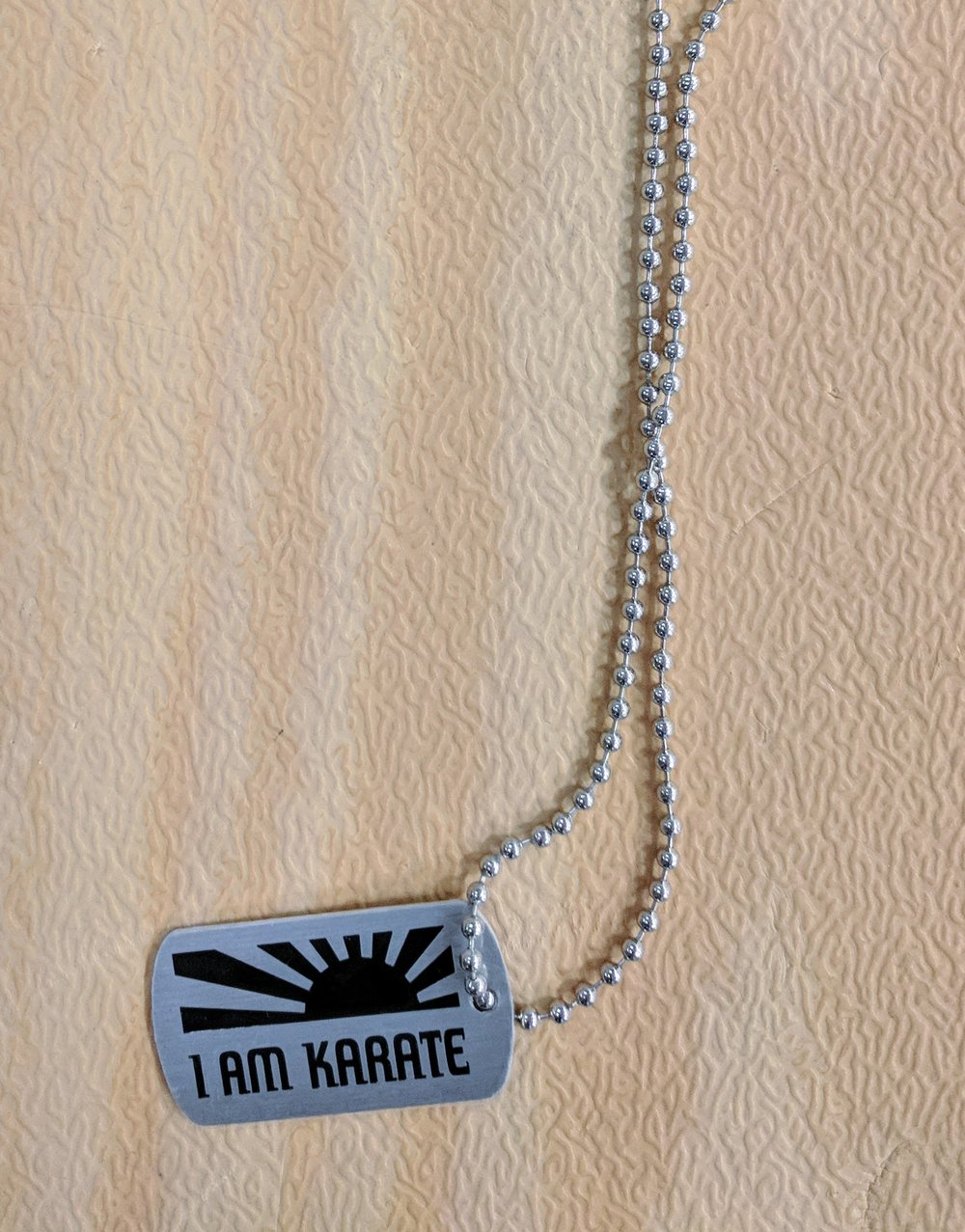 """I AM KARATE"" Dog Tag.....Simple but effective in stressing the point of studying karate.   $9.95 IN STOCK"