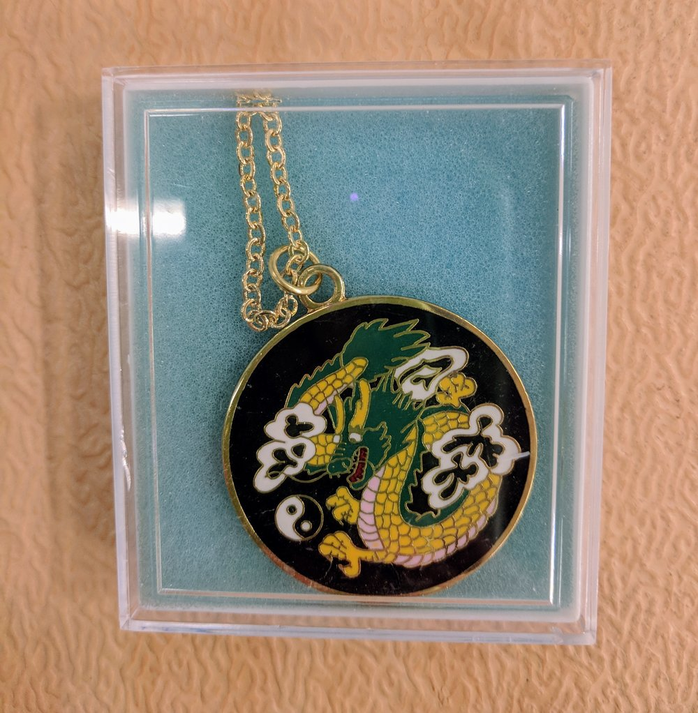 Dragon medallion that is worn around the neck.   $9.95 IN STOCK