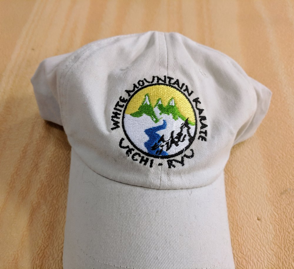 Soft brushed cotton hat displaying White Mountain Karate logo.  $9.95 IN STOCK