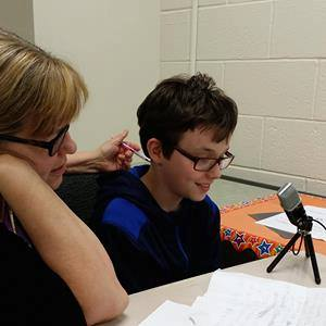 We  help young people record their  ideas and core values.  Dr  Blair listens to a young aspiring broadcaster share his!
