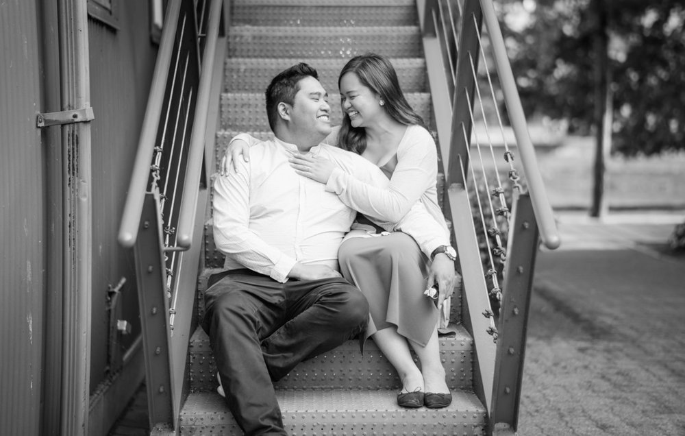 Granville-island-couple-embracing-engagement-session-photography