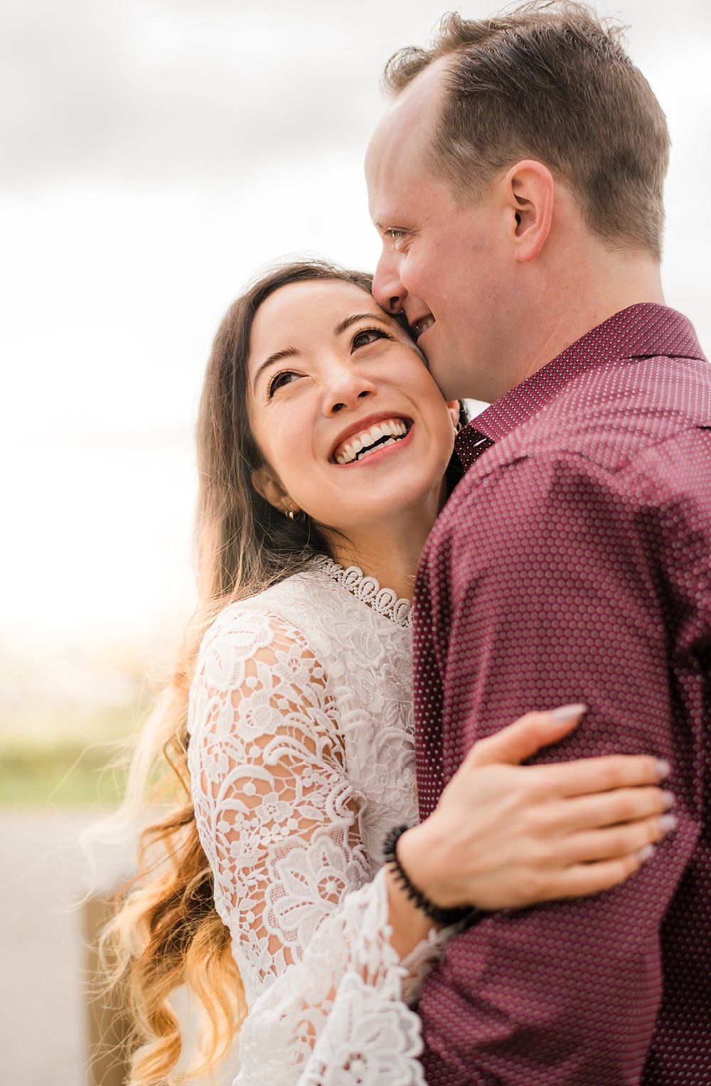 Engaged Couple embracing in Vancouver Engagement photography session