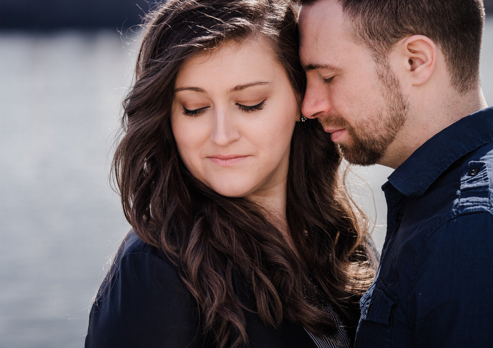 engaged-couple-with-vancouver-wedding-photographer-new-westminster-quay-phtography-session.jpg