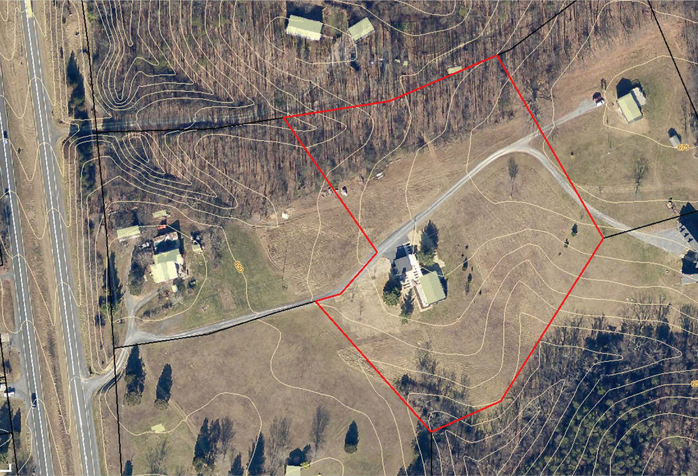 Aerial  photo of property and surrounding area, prior to installation of phase 1 design items