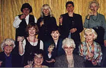 Another critique group. Here we toasted the publication of Carmen T. Bernier-Grand's first novel. Front: Carmen T. Bernier-Grand, Marian Martin; Middle: Dorothy Nafus Morrison, Pamela Smith Hill, Susan Fletcher, Eloise Jarvis McGraw; Back: Milena McGraw, Winnie Morris; Margaret Bechard; Liz Morris.