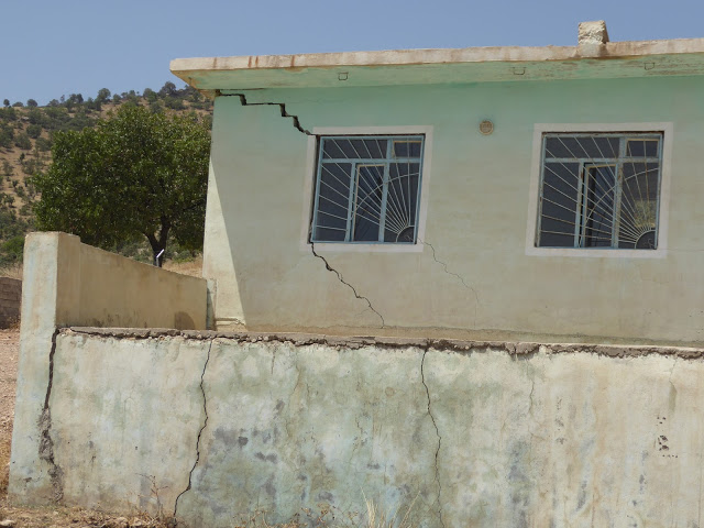 Cracks in walls of houses from bomb blasts. Photo by: Julie Brown.