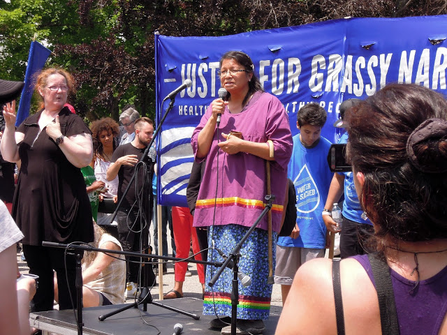 Judy Dasilva speaks at the River Run in front of the Legislative Assembly in Toronto. Photo: Kathy Thiessen