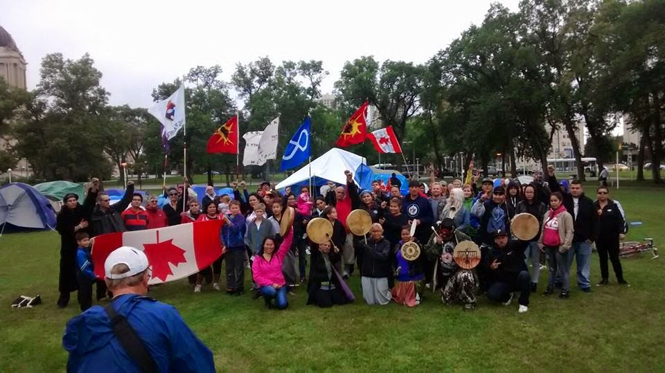 Participants in the protest encampment at the Manitoba legislature