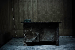 A desk within one of Amna Suraka's interrogation rooms.