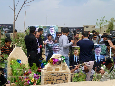 Family members, friends and colleagues gathered at the tomb